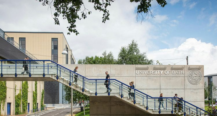 Exterior photograph of the University of Bath, with students climbing and descending a set of stairs across the frame